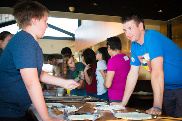 Scotty and Dylan making pizza at the California Pizza Kitchen Pumpkin and Pizzas Bonus Activity