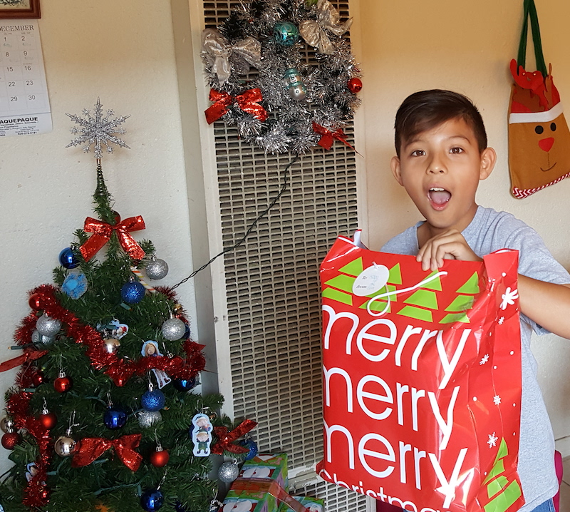 hope for the holidays mentee is full of joy with his holiday gifts