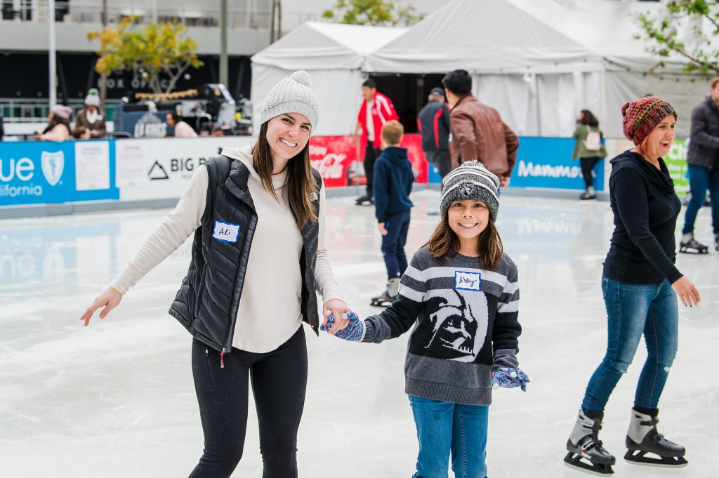 Mentor and Mentee ice skating at a Walk With Sally Friendship Activity at L.A. Live in Los Angeles