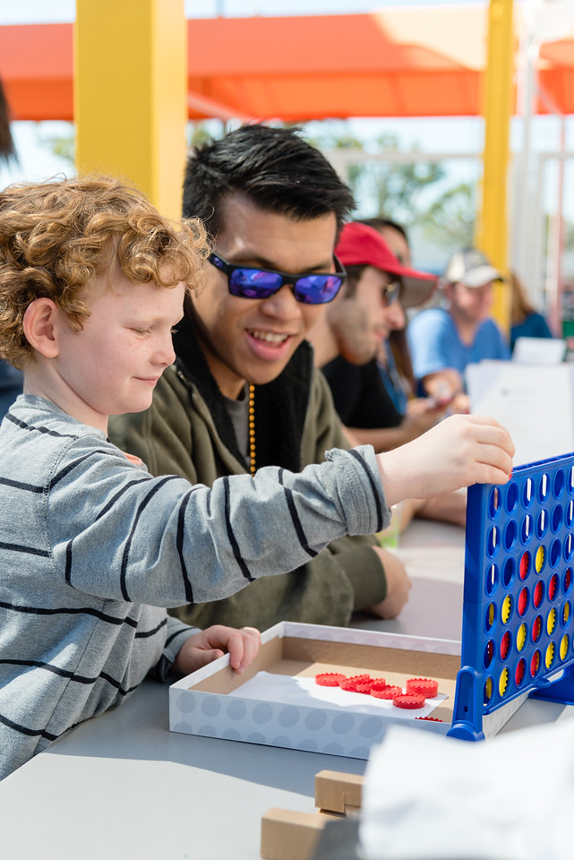 Walk WIth Sally mentor Maurice and his mentee Luke enjoy a game at a recent community based Friendship Activity for families impacted by cancer in Los Angeles